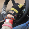 Globe/Roger Nomer<br /> Hayley Ward, 15, sports colorful bracelets along with her driving glove as she prepares to race at Eaglewood Speedway.
