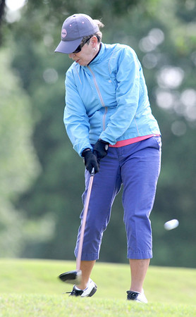 Pam Borland drives off the no. 1 tee during the Joplin Women's City Championship on Saturday at Twin Hills.<br /> Globe | Laurie Sisk