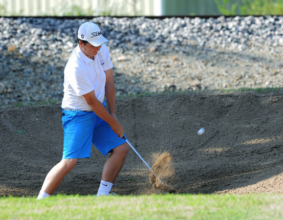 Globe/Roger Nomer Joplin High's Nick Yuhas hits out of a sand trap during district play at Twin Hills Golf Course on Monday.