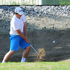 Globe/Roger Nomer<br /> Joplin High's Nick Yuhas hits out of a sand trap during district play at Twin Hills Golf Course on Monday.