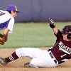 Monett's shortstop Hunter Witt gets  Rogersville's Jordan Fitzpatrick on the force at second during their state playoff game on Thursday at Monett.<br /> Globe | Laurie Sisk