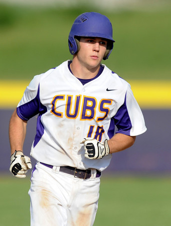 Monett sophomore Cameron Witt trots around the bases after hitting a 2-run homerun during the Cubs Class 4A District 11 championship game on Wednesday at Monett.<br /> Globe | Laurie Sisk