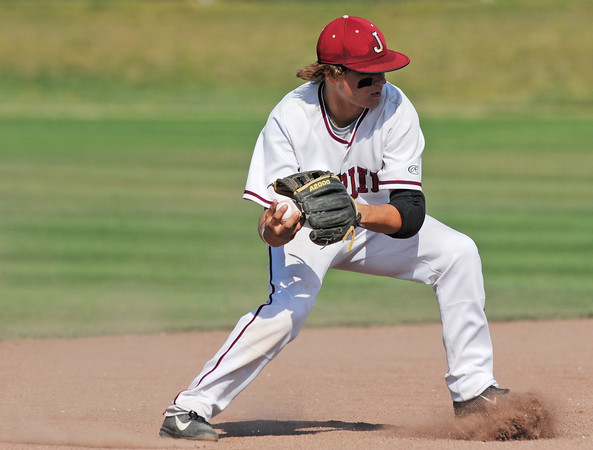 Globe/Roger Nomer<br /> Joplin's Chris Leonardi transfers a grounder to his hand as he prepares to throw to first during Wednesday's game at Joe Becker.