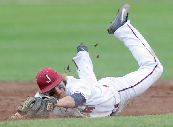 Joplin shortstop Chris Leonardi makes a stop of an errant throw during the Eagles game against Kickapoo on Tuesday at Joe Becker Stadium.<br /> Globe | Laurie Sisk