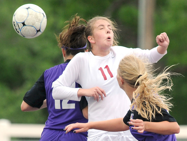 Joplin's Chelsea Nimmo, center, battles Camdenton's Ireland Betta, left and Allison Smith for a header during their match on Wednesday at Junge Stadium.<br /> Globe | Laurie Sisk