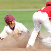 Joplin's Chris Leonardi slides under Ozark shortstop Caleb Essick's tag and steals second during the Eagles game against Ozark on Thursday at Joe Becker Stadium.<br /> Globe | Laurie Sisk