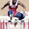Joplin's Dustin Hunter competes in the preliminaries of the high hurdles on Friday at the Girard Relays. Hunter finished fourth overall in the evnt.<br /> Globe | Laurie Sisk