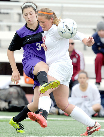 Joplin's Cortney Krolman, right, battles Camdenton's Mary Amerine for control of the ball during their match on Wednesday at Junge Stadium.<br /> Globe | Laurie Sisk
