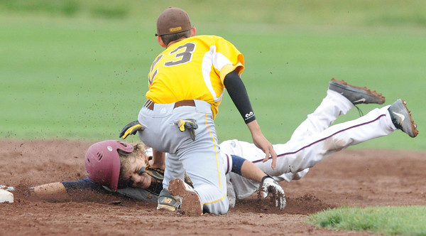 Joplin shortstop Chris Leonardi is tagged out trying to steal  by Kickapoo's Danny Crews during their game against  on Tuesday at Joe Becker Stadium.<br /> Globe | Laurie Sisk
