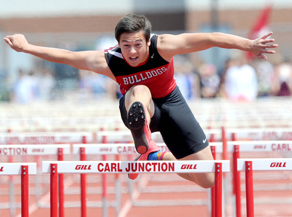 Carl Junction hurdler Kadin Brannin races to a first place finish in his preliminary heat of the boys 100m hurdles on Saturday at the Class 3A District 6 Championships ibn Carl Junction.<br /> Globe | Laurie Sisk