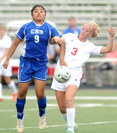 Carl Junction's Taylor Beck (3) and Carthage's Ana Luna (9) vie for control of the ball during their Class 2 District 12 championship game on Thursday at Webb City<br /> Globe | Laurie Sisk