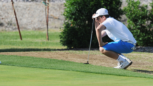 Globe/Roger Nomer<br /> Joplin High's Nick Yuhas lines up a putt during district play at Twin Hills Golf Course on Monday.