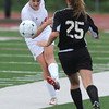 Globe/Roger Nomer<br /> Carl Junction's Cara Perkins clears the ball under pressure from Willard's Keara Maples during Tuesday's playoff game at Carl Junction.