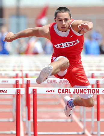 Seneca hurdler Braxton Graham races in his preliminary heat of the boys 100m hurdles on Saturday at the Class 3A District 6 Championships in Carl Junction.<br /> Globe | Laurie Sisk