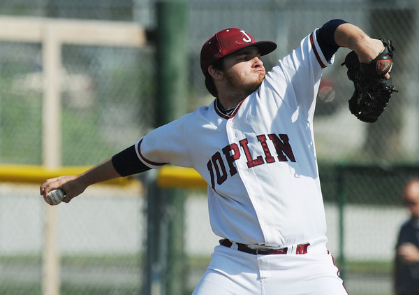 Globe/Roger Nomer<br /> Joplin's Kealin Smith delivers a pitch to a Glendale batter during Wednesday's game at Joe Becker.