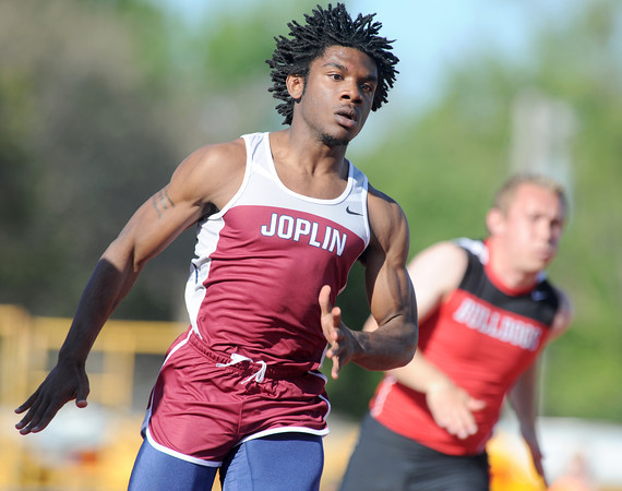 Joplin sprinter Eli Seay competes in the 200m dash preliminaries on Friday at the Girard Relays.<br /> Globe | Laurie Sisk