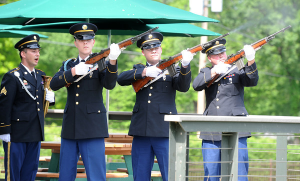 Members of the National Guard's Military Funeral Service Honor Guard, Joplin, offer a rifle salute for veterans from Missouri who lost their lives while in service to their country since Sept. 11, 2001. The salute was part of the Neosho Music Fest and Wounded Warrior Project on Saturday at the Neosho Fish Hatchery. <br /> Globe | Laurie Sisk