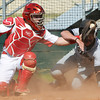 Globe/Roger Nomer<br /> Webb City's Tyler Davison applies the tag to0 late as Willard's Keaton Presley comes around to score in the third inning. The run started off a 14-run inning for Willard.