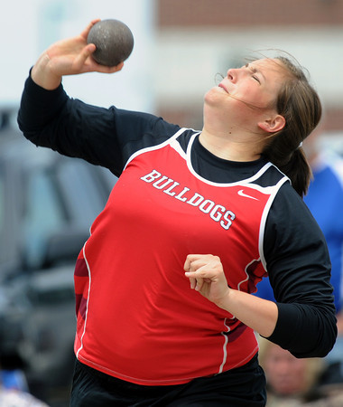 Carl Junction's KAtie Skaggs competes in the preliminaries of the shot put on Saturday at the Class 3A District 6 Championships in Carl Junction.<br /> Globe | Laurie Sisk