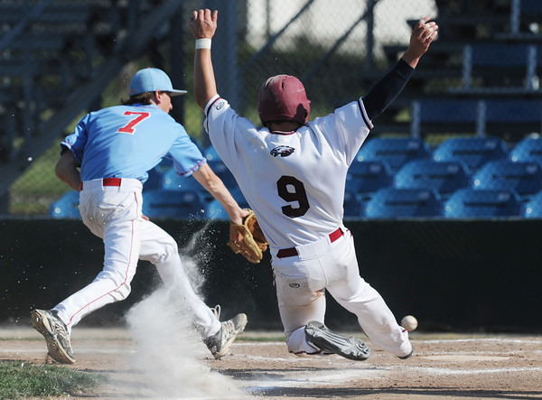 Globe/Roger Nomer<br /> Joplin's Tristan Ash beats the throw to Glendale's Alex Austin to score on a wild pitch during Wednesday's game at Joe Becker.