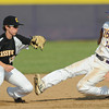Monett sophomore Cameron Witt beats the tag of Cassville second baseman Troy Rose during the Cubs Class 4A District 11 championship game on Wednesday at Monett.<br /> Globe | Laurie Sisk