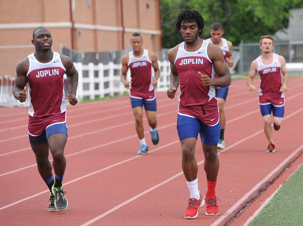 Joplin 4x100 relay members, from the left: Dustin HUnter, fr., Anthuan Jackson, jr. (alt.), Elijah Seay, jr., Colton HArbin, soph. and Adam Norsworthy, jr., warm-up before practice on  on Wednesday at Junge Stadium.<br /> Globe | Laurie Sisk