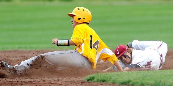 Joplin shortstop Chris Leonardi stretches to try and tag Kickapoo's Gus Reasoner during the Eagles game against Kickapoo on Tuesday at Joe Becker Stadium.<br /> Globe | Laurie Sisk