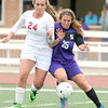 Joplin's Lauren Stringer, left, battles Camdenton's Bri Bullock for control of the ball during their match on Wednesday at Junge Stadium.<br /> Globe | Laurie Sisk