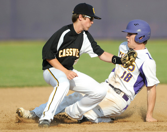 Monett sophomore Cameron Witt eludes the tag of Cassville second baseman Troy Rose during the Cubs Class 4A District 11 championship game on Wednesday at Monett.<br /> Globe | Laurie Sisk