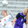 Joplin's Brittant Dutton, left, battles Camdenton's Allison Smith for a header during their match on Wednesday at Junge Stadium.<br /> Globe | Laurie Sisk