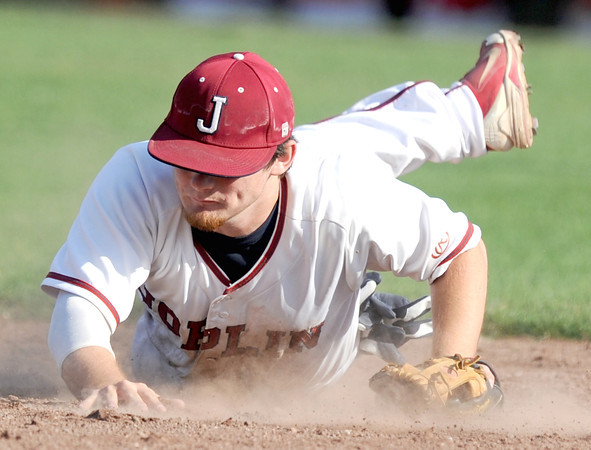 Joplin third baseman Kealin Smith makes a diving stop on a sharp grounder up the third baseline during the Eagles game against Ozark on Thursday at Joe Becker Stadium.<br /> Globe | Laurie Sisk
