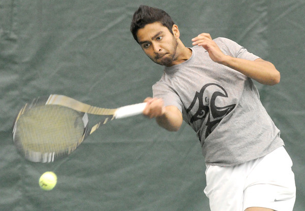 Joplin's Edran Ali returns a serve during his first match Saturday at the Class 2A State Tennis Tournament at Millenium Tennis and Fitness Center,<br /> Globe | Laurie Sisk