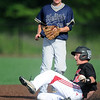 Aurora's Eric Shoenberger slides safely into second base as Helias' Alex Werner looks on during their state quarterfinal game on Thursday at Warren Turner Field.<br /> Globe | Laurie Sisk