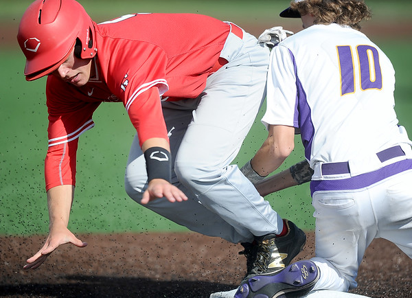 Carl Junction's Ben Luton slides safely into third as Monett's Brady Wright fields the throw after a passed ball during their Class 4, District 12 Championship game on Wednesday at Warren Turner Field. Luton later scored the Bulldogs' first run.<br /> Globe | Laurie Sisk