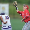 Carl Junction's Zach Snodgrass catches an infield pop up as Monett's Ian Meyer ducks to avoid a collision during their Class 4, District 12 Championship game on Wednesday at Warren Turner Field.<br /> Globe | Laurie Sisk