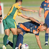 Demize player xx xxx (24) battles Tulsa's Matheus Goveia (11) during their game on Thursday night at Hershewe Field.<br /> Globe | Laurie SIsk