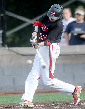 Aurora's Matthew Miller puts his team ahead with an rbi in the bottom of the fourth inning during their state quarterfinal game against Jefferson City Helias on Thursday at Warren Turner Field.<br /> Globe | Laurie Sisk