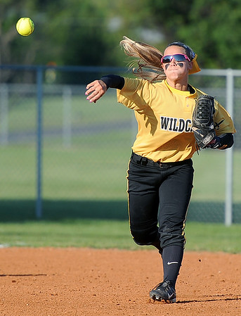 Diamond shortstop Whitney DeGonia throws a runner out at first base during the Wildcats' Class1, District 11 semifinal game against College Heights on Tuesday at Diamond. Globe   Laurie SIsk