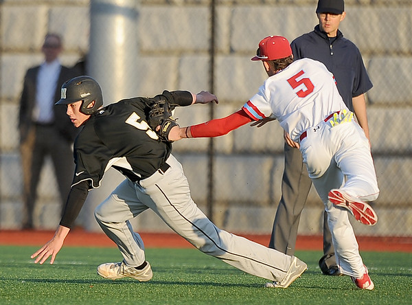 Webb City's Dack Sanborn catches Neosho pinch runner Gavin Kelley in a rundown between first and second during their Class 5, District 12 championship game on Wednesday at Joplin High School.<br /> Globe | Laurie Sisk
