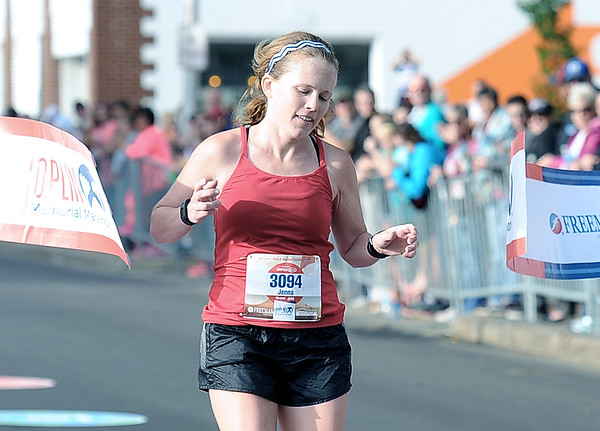 Jenna Mutz races to a first place finish in the women's half marathon during the Joplin Memorial Marathon on Saturday at Memorial Hall. <br /> Globe | Laurie Sisk