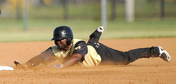Blasters speedster xxx (2) slides safely into second base during their game against the New Jersey Black Sox on Thursday night at Wardog Stadium in Miami.<br /> Globe | Laurie Sisk