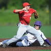 Carl Junction's Ben Luton completes the front end of a successful double play as Monett's Cameron Witt tries to break up the play during their Class 4, District 12 Championship game on Wednesday at Warren Turner Field. Luton later scored the Bulldogs' first run.<br /> Globe | Laurie Sisk