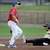 Joplin's Mitch Glasser easily steals second base on a passed ball as Topeka's xx xx (15) looks on during an exhibition game against the Topeka Trainrobbers on Friday night at Joe Becker Stadium.<br /> Globe | Laurie Sisk