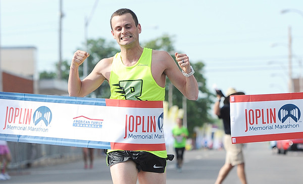 Drew Conner, of Fayetteville, Ark., claims first place in the Joplin Memorial Marathon on Saturday.<br /> Globe | Laurie Sisk
