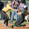 Diamond's Zoe Renfro gets the put out as College Heights' Kaycie Gibson tries to stretch a hit into a triple during their Class1, District 11 semifinal game on Tuesday at Diamond.<br /> Globe | Laurie SIsk