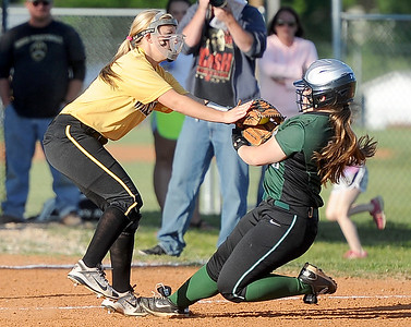 Diamond's Zoe Renfro gets the put out as College Heights' Kaycie Gibson tries to stretch a hit into a triple during their Class1, District 11 semifinal game on Tuesday at Diamond. Globe | Laurie SIsk