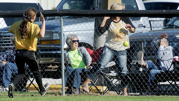 Diamond rightfielder Sidney McMullen watches a home run fly over the fence as fans react during the Wildcats' Class1, District 11 championship game against Liberal on Wednesday at Diamond.<br /> Globe | Laurie Sisk