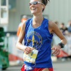 Laura Blaylock is all smiles as she brings in a first place finish in the women's full marathon at the Joplin Memorial Run on Saturday at Memorial Hall. <br /> Globe | Laurie Sisk