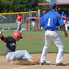 Carl Junction's Justice Hylton slides safely into third as Seneca's Jesse Rhoades looks on during their game on Saturday at CJHS.<br /> Globe | Laurie Sisk