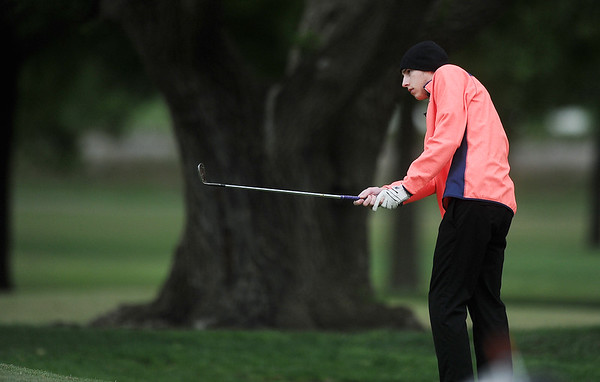 Globe/Roger Nomer<br /> Neosho's Cameron Clemons chips onto the green on Monday at Twin Hills.
